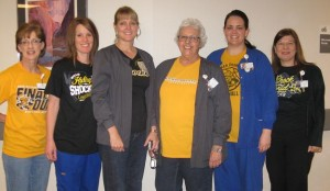 KHH employees enjoy the WSU Shockers in the Final Four by wearing Shocker gear and jeans.